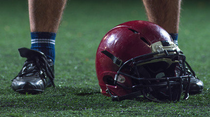 closeup of american football player and helmet