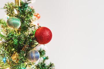 Christmas decoration background. Christmas tree with colorful decoration, on white background