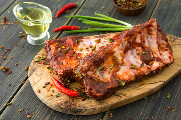 Smoked spiced juicy spareribs with red peppers, green onion and