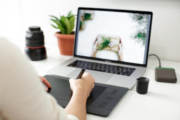 retouching on computer laptop