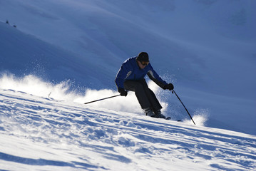 Skier on the mountain slope