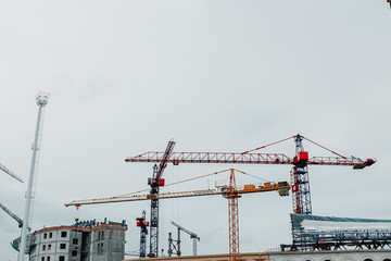 many construction cranes on blue sky - construction site Copy space.