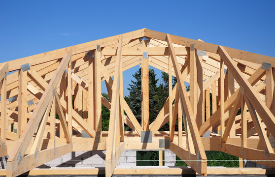 Roof trusses. Roofing Construction House Roof Building.Timber roof truss. Trusses and Framing Home Roof.