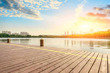 wooden board observation deck and lake landscape in city park Fototapete