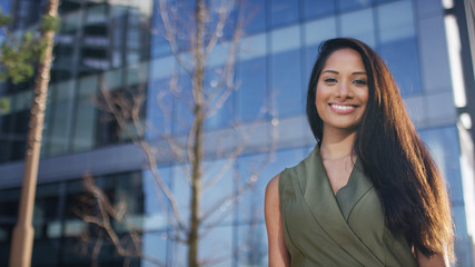 Portrait of attractive female professional outside office building