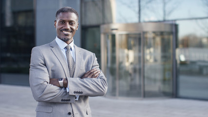 Portrait of confident male business man smiling to camera, with space for text