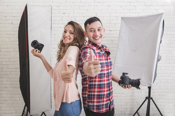 two young photogaphers giving thumbs up