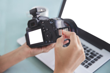 hand of photographer inserting the memory card to the camera