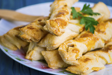 Sticks of puff pastry with ham and cheese