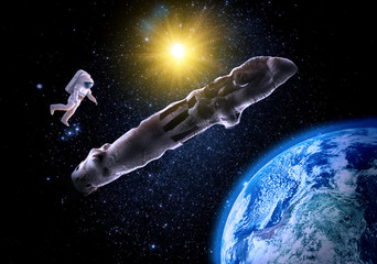 Astronaut with mysterious alien object oumuamua in space