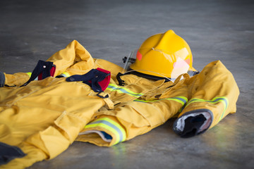 fireman protection suit and helmet standby on ground at fire station