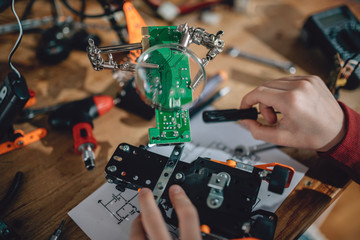 Wall Mural - Circuit board under magnifying glass