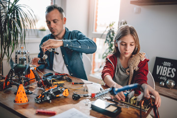 Wall Mural - Father and daughter building robot
