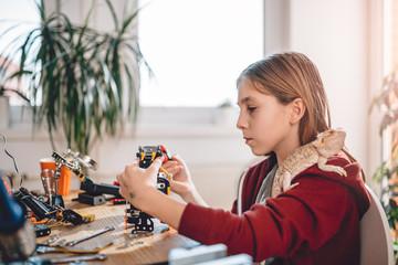 Wall Mural - Girl building robot