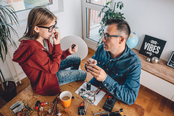 Wall Mural - Father and daughter working together in workshop