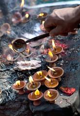 Offering candles at Dakshinkali Hindu Temple in Pharping, Nepal