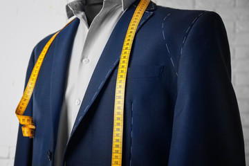 Semi-ready suit on mannequin indoors, closeup