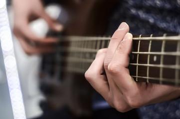 Guitarist playing electric guitar, close-up.