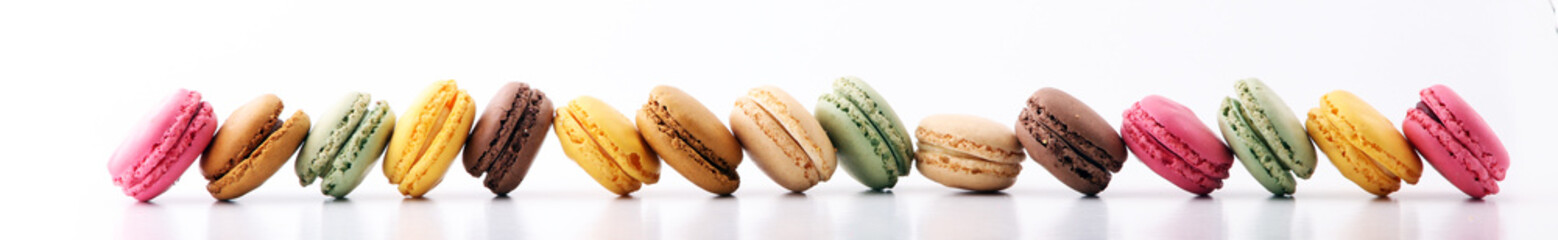 Deurstickers Dessert Sweet and colourful french macaroons or macaron on white background, Dessert