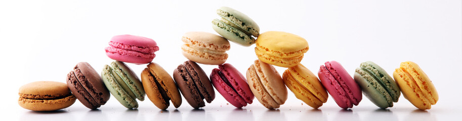 Foto auf Leinwand Macarons Sweet and colourful french macaroons or macaron on white background, Dessert
