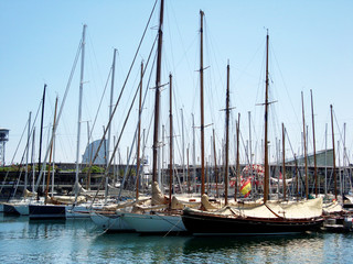 Yachts and catamarans located in the port of Barcelona, Spain.