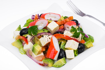 Vegetable salad with avocado, surimi and fetus