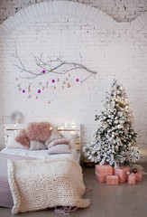 Christmas decor in soft pink color in the bedroom.