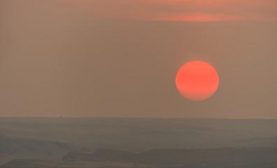 Big Round Hot Orange Sun Nearing Horizon Summer Sunset