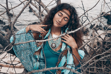 beautiful young woman outdoors. witch craft concept
