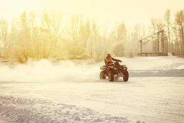 ATV driving on a snowy highway.