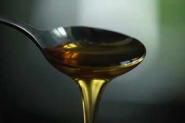 organic honey dripping from spoon