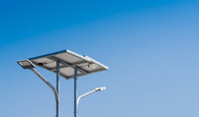 LED street light with solar cell in blue sky background. Green energy concept. concept.