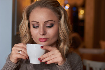 Portrait of a blonde with cup of coffee