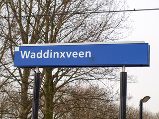Name sign of station Waddinsveen on platform