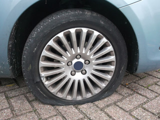Flat tire on a person car