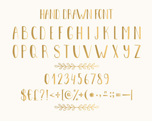 Golden hand drawn letters and numbers