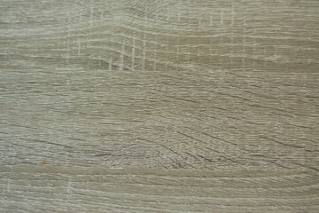 Light grey wooden pattern background.