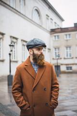 Stylish bearded man in city
