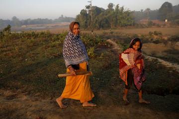 Sabura Khatun, a Rohingya refugee walks with her daughter to cut firewood near the Palongkhali refugee camp near Cox's Bazar