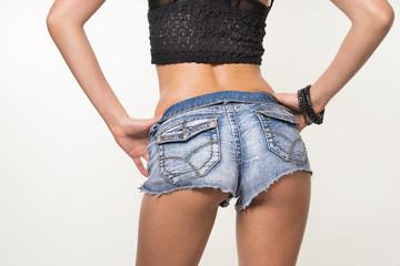 Woman wearing denim short shorts