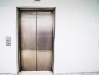 Elevator lift with metal sliding doors