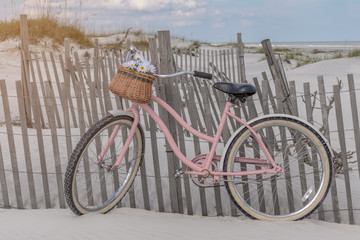 Garden Poster Bicycle Pink bicycle on beach dunes in summer sun