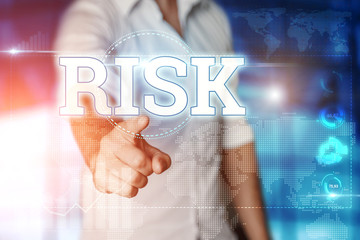 "Businessman clicks on a virtual screen and selects ""RISK"". Blue background. Business concept. Mixed media"