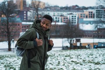 Tourist man in snowy city
