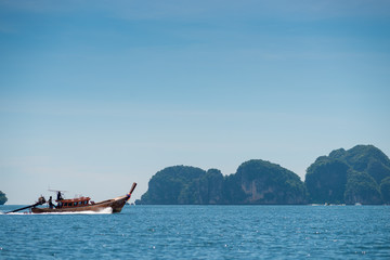 fast wooden Thai boat in the Andaman Sea in sunny weather, Thailand