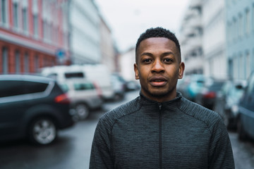 Portrait of young man standing on street