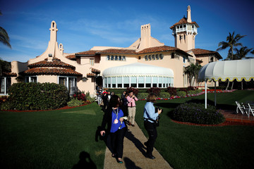 Members of the media are seen at Mar-a-Lago estate after attending a Christmas Eve video teleconference between U.S. President Donald Trump and members of the military in Palm Beach, Florida