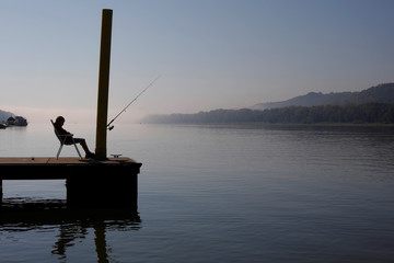 A boy fishes in the Ohio River in New Richmond