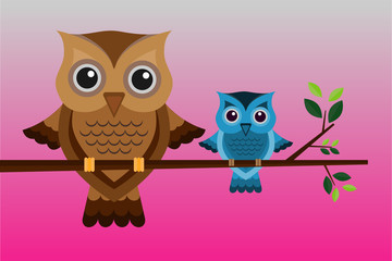 Two brown and blue owls on a branch