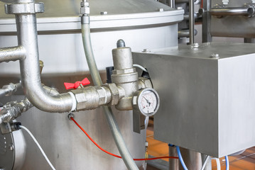 Manometer on a shining tube. Equipment for food industry